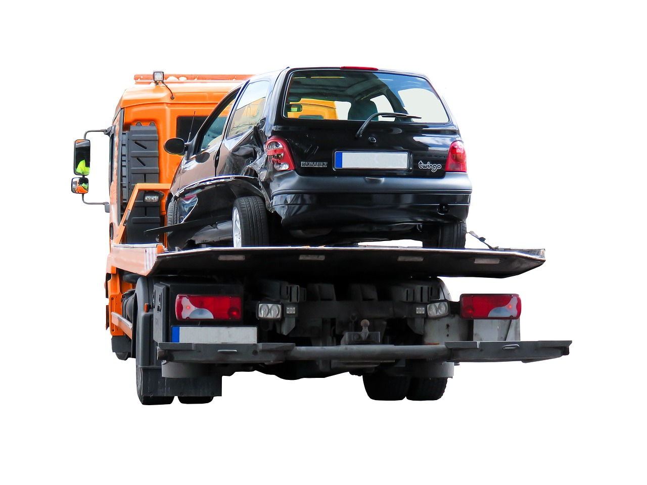 Flatbed Tow Truck Carrying a Damaged Car